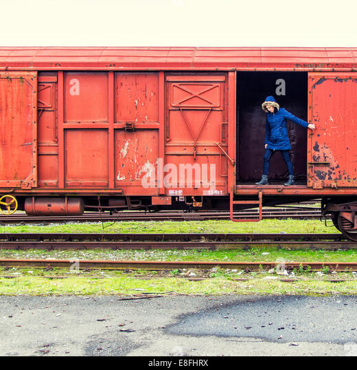 Woman standing in train carriage - Stock Image