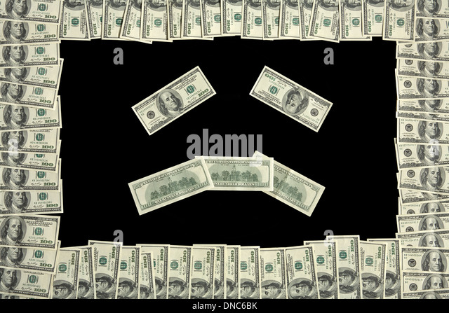 Sad face in dollar bill frame - Stock Image