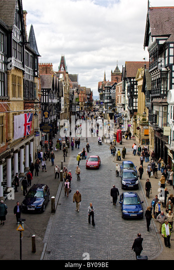 Street scene of people in an old English city - Stock Image
