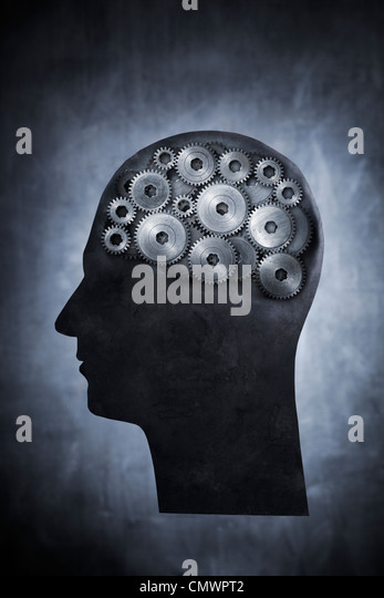 Conceptual image of head filled with cog gears. - Stock-Bilder