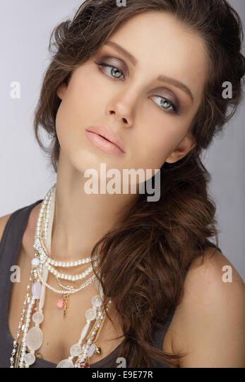Natural Brunette with Pearly Necklace with Beads - Stock Image