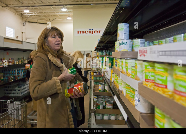 Volunteers Work at Food Pantry - Stock Image