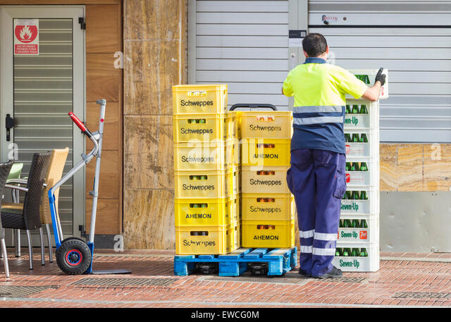 Delivering soft drinks and alcohol to beachfront bars in Spain - Stock Image