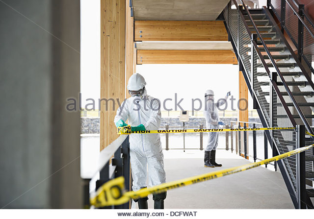 Water technicians blocking off water access - Stock Image