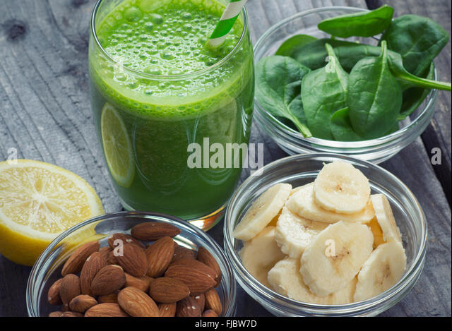 Green fresh healthy smoothie with fruits and vegetables - Stock Image