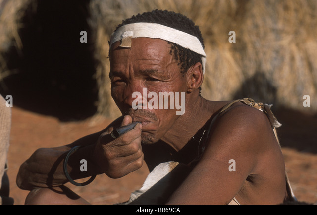 !Kung San man smoking - Stock Image