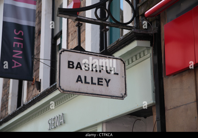 Sign 'Bashful Alley' on city street - Stock Image