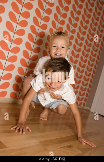 Two Young Boys playing - Stock-Bilder