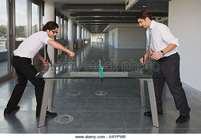 Two businessmen playing table tennis - Stock Image