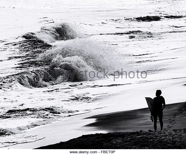 Surfer Looking At Waves - Stock Image