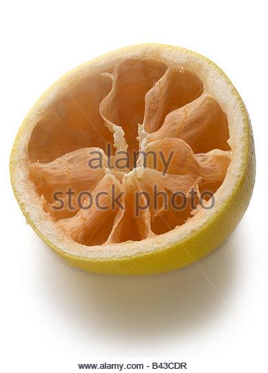 half a grapefruit eaten - Stock Image