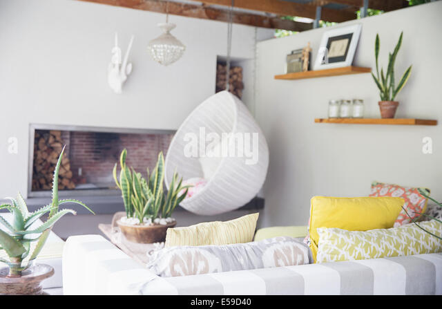 Sofa, chair and fireplace in modern living room - Stock Image
