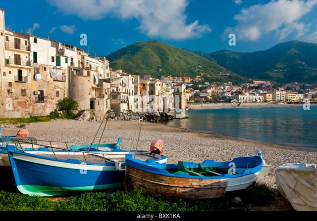 Boats on beach, Cefalu, North coast, Sicily Italy - Stock Image