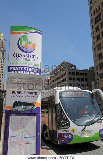 Maryland Baltimore Charm City Circulator public transportation purple route bus free shuttle Pratt Street stop eco - Stock Image