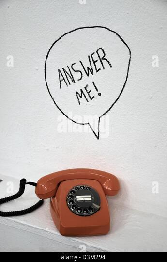 Vintage orange telephone - Stock Image