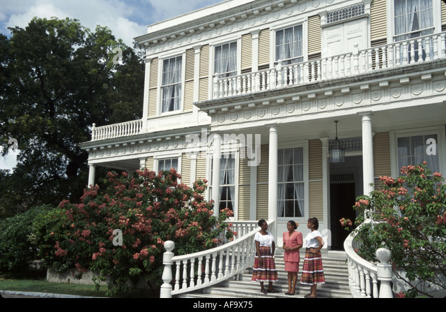 Jamaica Kingston Devon House built 1881 historic urban plantation house Black female guides period clothing - Stock Image