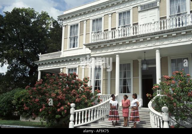 Jamaica Kingston Devon House built 1881 historic urban plantation house Black female guides period clothing - Stock Image