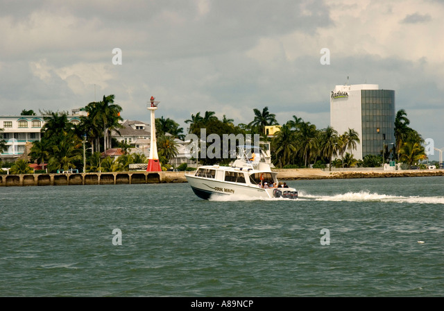 Belize City Belize harbour harbor skyline and power boatg - Stock Image