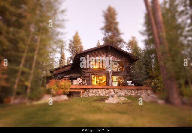 Beautiful Log Cabin Exterior Among Pine Trees - Stock Image
