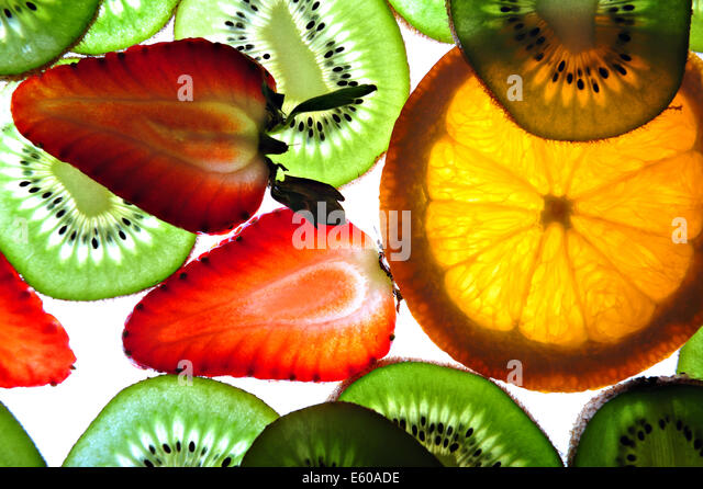 Slices of strawberry, kiwi, and lime - close up - Stock Image