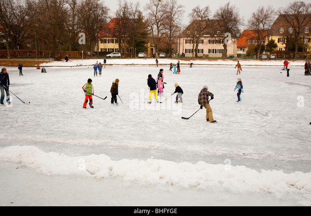 Fun on frozen lake - Stock Image