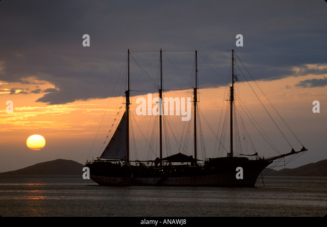 Venezuela Puerta la Cruz Barefoot Windjammer's SV Fantome anchored Caribbean Sea schooner cruise sunset sail - Stock Image