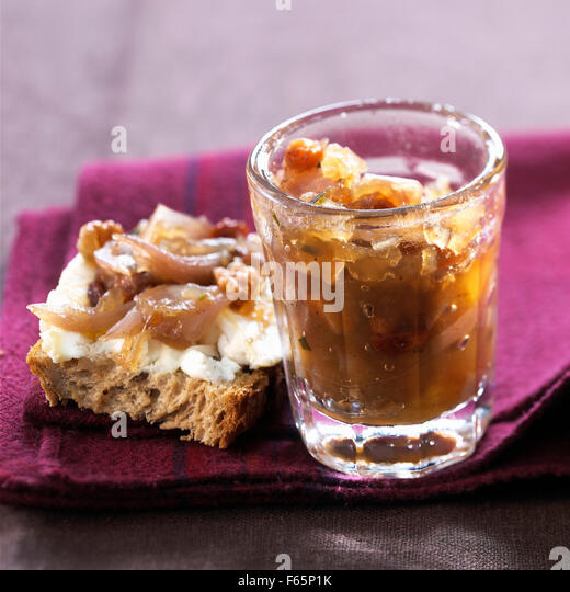 jar of shallot chutney and goat's cheese and shallot chutney open sandwich - Stock Image