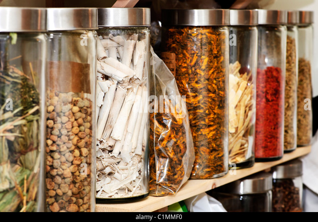 Traditional chinese medicine herbs and remedies in jars - Stock Image