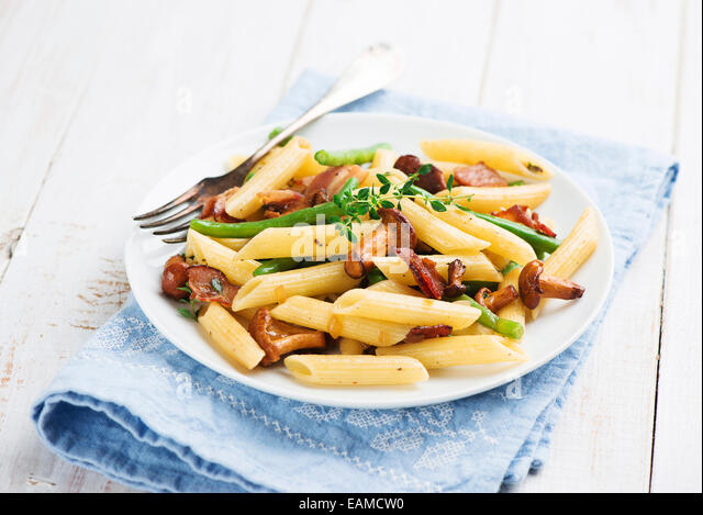 Pasta with chanterelles mushrooms - Stock Image