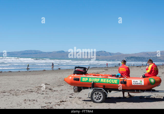 Surf Rescue inflatable boat on New Brighton Beach, New Brighton, Christchurch, Canterbury Region, New Zealand, - Stock Image