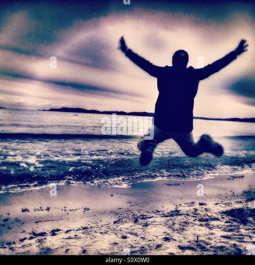 Happy man on the beach, Mediterranean Sea - Stock Image