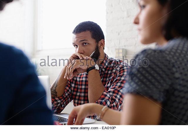 People in a meeting in Small Business, Start-up - Stock Image