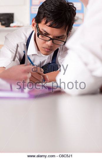 Students working together in vocational classroom - Stock Image