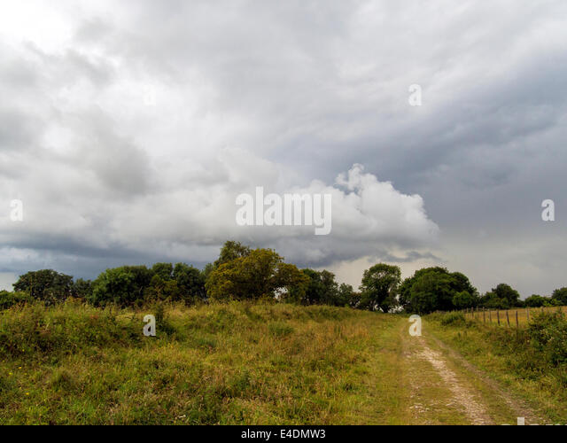 Thunderstorm, probably over Chichester, from Bignor Hill, West Sussex, England, UK, on the South Downs Way - Stock Image