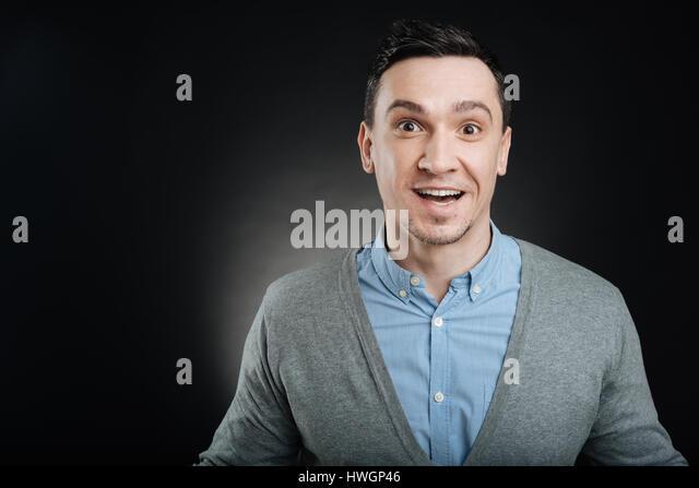 Young emotional man expressing surprise - Stock Image