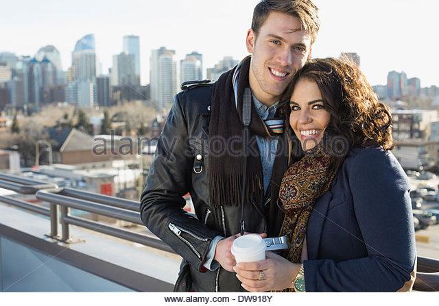 Portrait of smiling couple on patio - Stock-Bilder