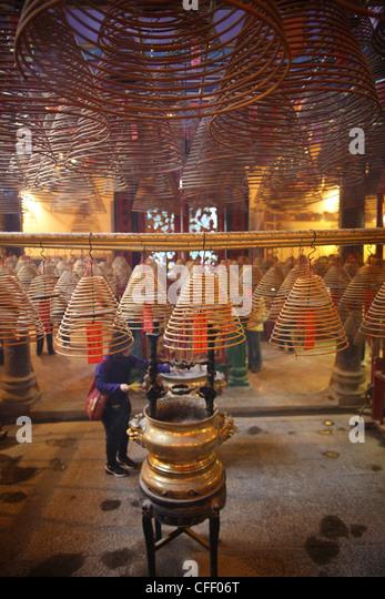 Incense coils in main hall, Man Mo Temple, Hong Kong, China, Asia - Stock Image