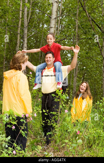 Family Having Fun AK Botanical Garden SC Summer Anchorage - Stock Image