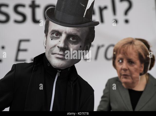 Frankfurt am Main, Germany. 10th Oct, 2017. Activists wear masks of German chancellor Angela Merkel and French president - Stock Image