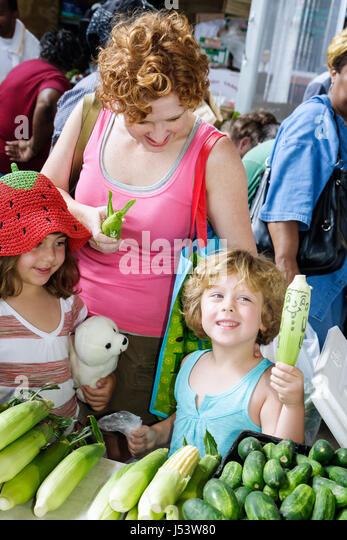 Little Rock Arkansas River Market Farmers Market buyers sellers locally grown produce woman girls hat stuffed animall - Stock Image