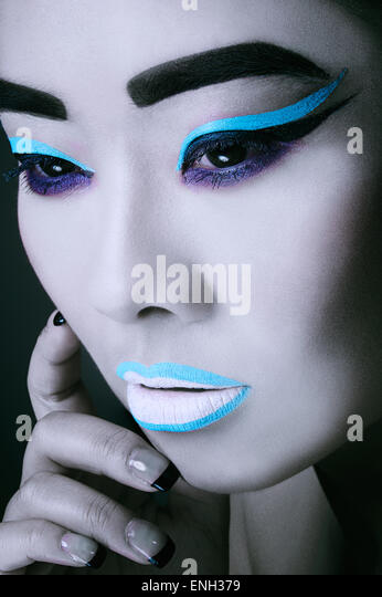 Beauty close-up of East Asian young woman in bold make-up - Stock-Bilder