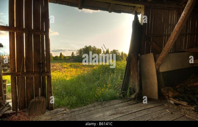 Summer landscape through barn door - Stock Image
