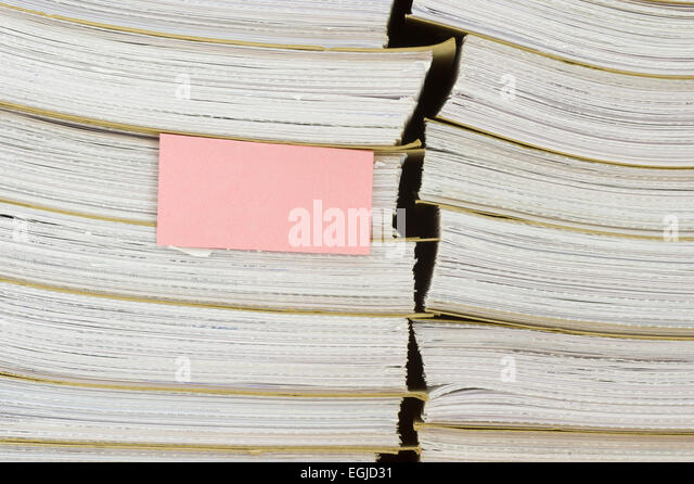 A pile of archival documents with blank bookmark - Stock Image