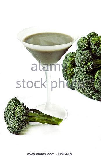 Broccoli shake and uncooked broccoli - Stock Image