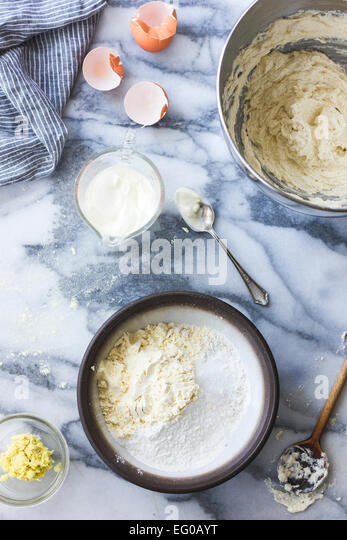 Cake ingredients on marble. - Stock Image