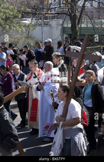 Roman Catholics of various ethnic groups participate on Good Friday in a procession of 'The Stations of the - Stock-Bilder