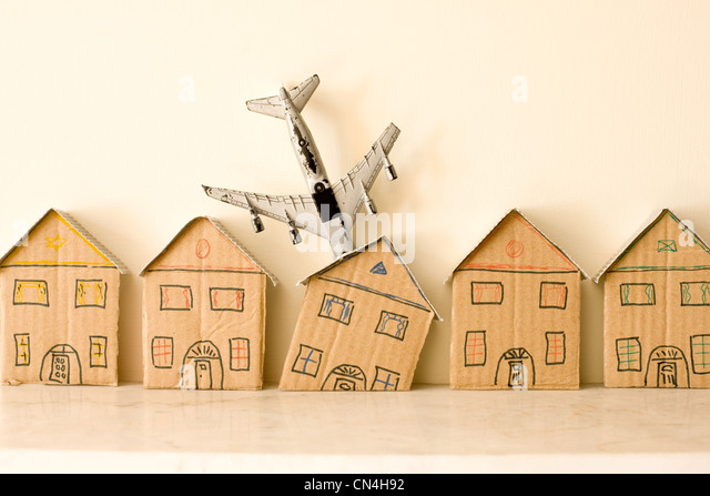 Model plane crashing into terrace house - Stock Image