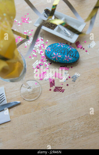 Restaurant interior Reserved table sign Painted pebble Table decorations Birthday celebrations Pretty Colourful - Stock Image
