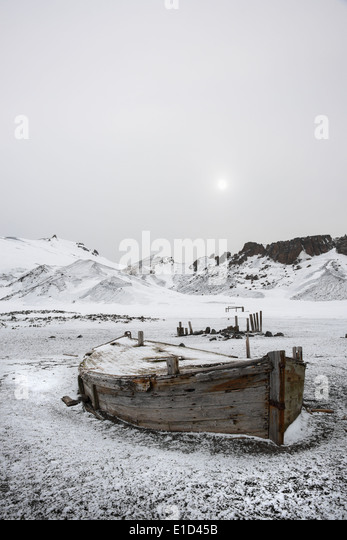 A wooden boat hull beached on Deception island, a former whaling station. - Stock Image