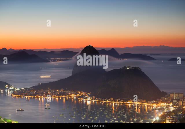 View of Sugarloaf Mountain and Botafogo Bay at dawn, Rio de Janeiro, Brazil - Stock Image